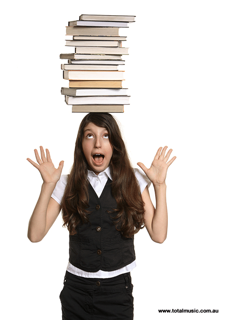 Girl with great posture balances books on her head